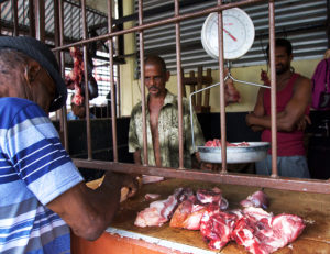 butcher-in-meat-market-soufriere-saint-lucia