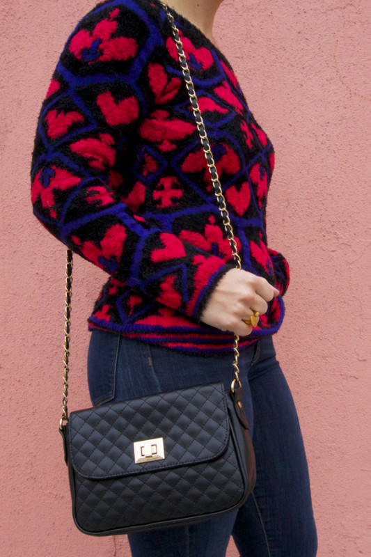gold ring, bag and queen of hearts sweater