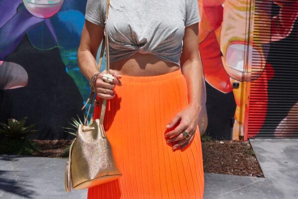 coral-skirt-gold-bag-ring-details